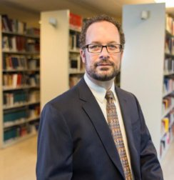 Headshot of  Rare Books Curator, John Butchel