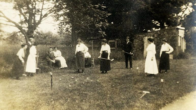 Staff playing croquet