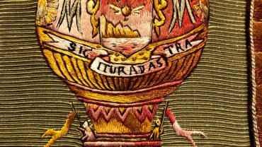 Detail of an embroidered binding from a French two-volume history of ballooning from 1887-1890.
