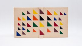 Book binding with a light background covered with several colorful triangles